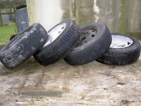 FREE TO GOOD HOME FOUR USED 165/65 R13 TYRES ON STEEL RIMS