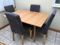 Extending Dining Table With 4 Grey Chairs