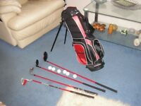 Junior left hand golf bag and clubs suitable 6 - 8 years