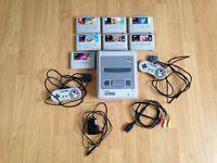 Super Nintendo SNES + 2 Controllers + 7 Games £150 !