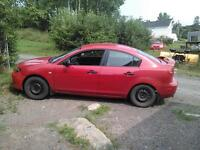 Looking to trade my 2005 Mazda 3 for a truck