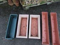 FOUR USED PLASTIC GARDEN TROUGHS. NOTTINGHAM OR CROMFORD