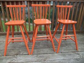 3x orange children's wooden high chair