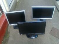 three computer flat screen monitors
