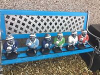 Set of 6 stone rugby player garden ornaments in 6 nations colours