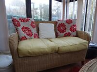 Conservatory or Garden Room Wicker Sofas and Matching Table. Beautifully made by the Pier .