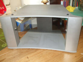 Grey television stand with a glass shelf