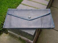 A vintage navy blue leather clutch bag.
