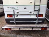 Motorbike or scooter rack for motor home, caravan or trailer