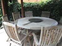 Teak round table with lazy Susan & 8 chairs