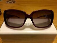 DKNY woman's purple sunglasses with case and cleaning cloth