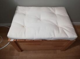 Storage box with a cushion