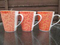 12 brand new ceramic mugs