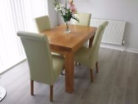SOLID OAK TABLE AND CHAIRS IN GREAT CONDITION,OAK FURN LAND