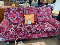 Red floral three seater and two seater sofa with armchair and footstool