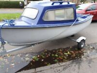 Boat trailer and engine