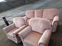 pink fabric covered 3 seater sofa and 2 armchairs