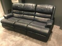 Navy blue leather three seat sofa with manual recliners at each end