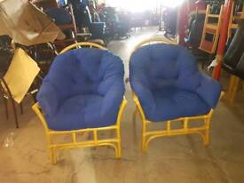 Blue cushioned wooden chairs
