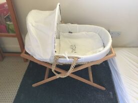 Moses basket with white covers and mamas and papas stand