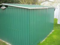 A Metal garden storage shed approximatly 10feet by 8 feet. in good condition.