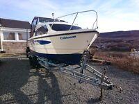 Shetland 4 plus 2 motor boat, sleeps four internal cabin, braked trailer included.