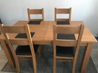 Solid oak extending dining table & 4 solid oak leather chairs