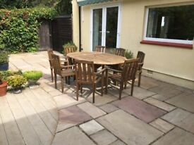 Extending teak garden table and 8 chairs