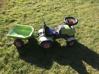 Green push-along children's tractor with trailer