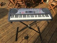 Casio Keyboard with stand and power lead.