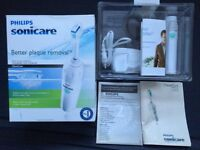 PHILIPS SONICARE ELIT SERIES, HANDEL AND CHARGER WITH BOX, USED EXCELLENT WORKING CONDITION.