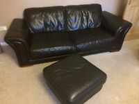 Brown leather sofa's, arm chair, and foot stool