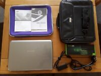 """Samsung Laptop X520 15.6"""", 4 GB, 500 GB, new battery, and carry cases"""