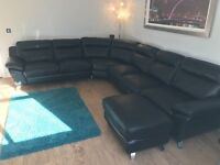 DFS 'Dice' black leather corner sofa with footstool