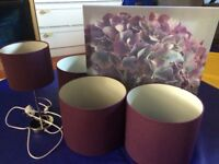 Three light shades, lamp and shade and canvas in plum