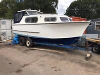Boat. Freeman 23 with inboard engine and trailer.
