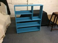 a lovely wooden bookshelf that can stand alone or be wall mounted, painted blue and furniture waxed