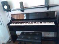 ROLAND ELECTRIC PIANO D.P 99OR