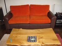 Orange cushion covers - Sorry, not the sofa