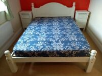 white double bed and mattress