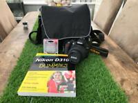 Nikon D3100 digital SLR camera, with accessories