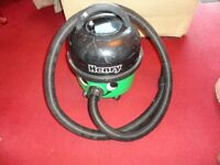black and green henry hoover in good working order with pipe