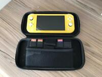 Nintendo switch lite + 3 Games and case