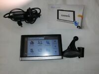 Two sat nav's one older Tomtom one up to date Garmin Nuvi