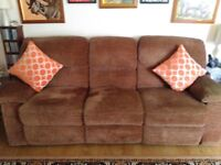 Three seater DFS recliner sofa in light brown chenille fabric