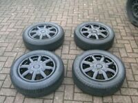 SET 4,ABSOLUTELY STUNNING,15 INCH,4 STUD,4 X 100 PCD,BLACK ALLOYS,CENTRES,175/65/15s