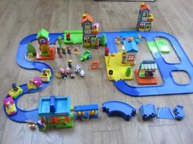 Happyland playset with lots of road, buildings and characters