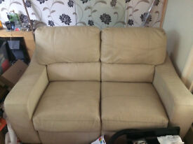 Sofa - two seater cream leather settee