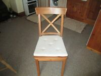 4 IKEA INGOLF chairs in good condition. Includes 4 seat cushions.