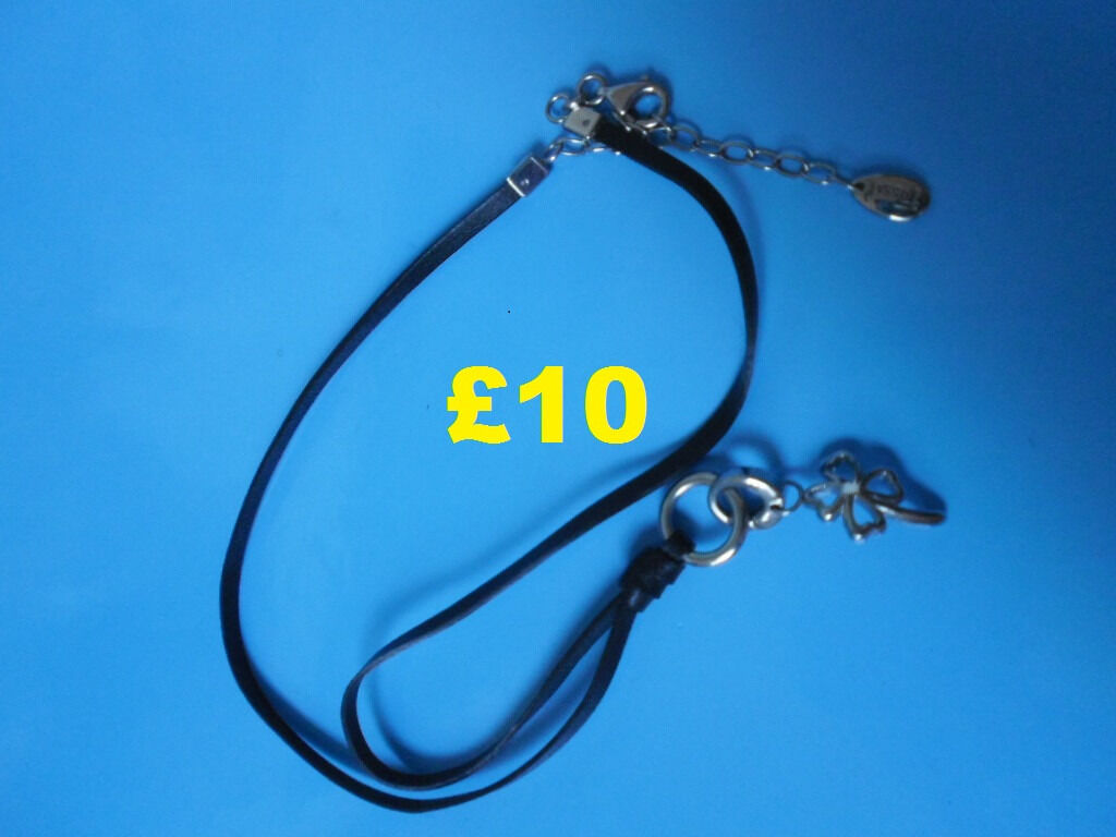 """Fossil Necklacein Ellesmere Port, CheshireGumtree - Fossil Necklace with Charm, leather necklace 16"""" long with fossil tag & a charm, which is a 4 leafed clover, never worn, £10. All money raised will be used for vets & general upkeep of our rescued animals. Collection Only from Ellesmere Port or..."""